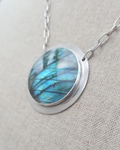 Check out this item in my Etsy shop https://www.etsy.com/uk/listing/251198059/sale-round-labradorite-necklace-dn0005