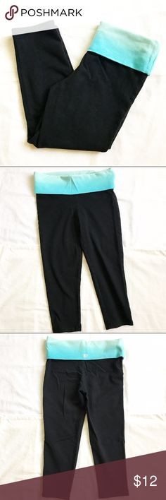 """Cropped Workout Leggings Forever21 cropped workout leggings in good to fair condition. Ombré blue folded waist. Length is approx 23.5"""". 90% cotton; 10% spandex. Black color is slightly faded and there are two very small light spots (by my thumb on the last picture) on the inside of the folded waist (so it's hidden and not noticeable). Forever 21 Pants Leggings"""