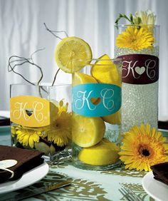 The options of what to fill your centerpieces with are endless! The fresh, vibrant color of lemons is perfect for any occassion, and to personalize simply add your initals on the vase! #marvelous #centerpieces #middles #fresh #spring