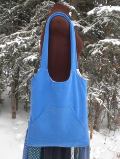 "Sweatshirt purse. I love the ""scene"" they used to sell this purse. A naked dress form in the snow."