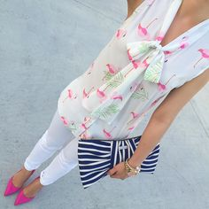 StylishPetite.com | Flamingo bow blouse, Kate Spade lottie pumps, Kate Spade Georgica striped bow clutch, petite white jeans, Spring outfit, pattern mixing