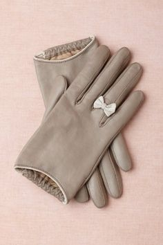 Have a TrèsSugar Holiday: Our Editors' Girlie Gift Guide: I'm obsessed with the little white bow on these gray leather gloves ($150).  — Tara Block, assistant editor