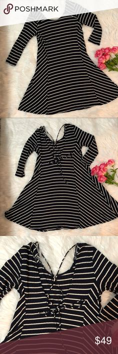 Lush Stripped Dress Beautiful nd comfortable dress. The back is slightly open with string tie as seeing on pic. Super cute and playful looking. Only worn once. Lush Dresses Midi