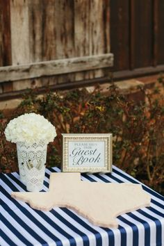 """Steer clear from the traditionalguest book and use one of these fun guest """"book"""" ideas for your wedding! 1. Shadow Box of Tiny Hearts Have your guests sign little wooden hearts and place them all in a shadow box for you to display. Perfect idea for your Texan guests to share som"""