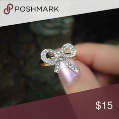 Rose gold tone CZ Diamond bow fashion ring Cubic zirconia bow shaped fashion ring. Fits like a size 6 but is adjustable. Jewelry Rings