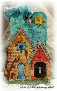 Anne's paper fun: Grunge Monday # 5 I like the rooflines, made of print and sheet music, and the keyhole doors, especially