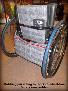 Re-upholstered Wheelchair...subtle snakeskin design; made a matching removable shoulder bag that hangs at perfect length around seat of chair for added storage when using the chair in public