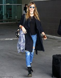 Keeping it casual: Behati opted for a pair of ripped jeans, a pair of Dr Martens boots and a Stevie Howell scarf