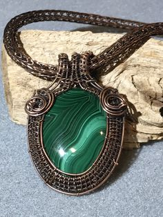 Wire woven malachite on a handwoven Viking Knit chain.  Www.perfect-duo.com