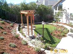 Love the stairs on the far side and the low maintenance of mulch and a few plants