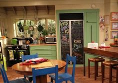 Good Luck Charlie Kitchen. I love the bright colors and chalkboard fridge with quotes relating to the particular episode.