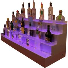 Made of acrylic, our LED bottle tiers bring a higher quality than our competitors who use wood and/or MDF to cut costs. Bar Shelves, Display Shelves, Types Of Lighting, Bar Lighting, Wine Bottle Display, Bar Interior, Liquor Bottles, Led, Home Office Decor