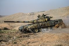 Syrian government army tank near the town of Palmyra. Syrian government troops are storming the last Islamic State (banned in Russia) strategic elevated position near the ancient town of Palmyra. Valery Sharifulin/TASS