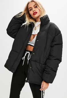 Jacket in a black hue with oversized fit and puffer style.