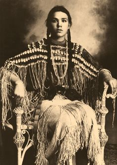NATIVE AMERICAN: Sitting for a formal portrait by Edward Curtis, a girl from the Kiowa tribe in Washington state.