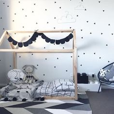 @happylittletenant randomly scatters @homelycreatures triangle wall decals! Also love how our black felt bunting and sleeping bear looks in @thislittlelove_au's cubby ✖️✖️✖️