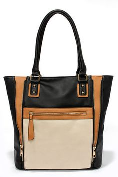 "Stylish and functional, our Totes Chic Black Color Block Tote will prove your fashion sense! Panels of tan and beige vegan leather accent the front of this soft black vegan leather tote, with a sleek zipper pocket and functioning gold zippers on front, and a second zipper pocket at back. Open the zip top to find an extra spacious fabric lined interior with three side wall pockets for all of your essentials. Vegan leather, twin tote handles have a 9"" drop. Tote measures 18"" wide, 14"" tall…"
