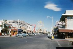 Fremont Street at 3rd, Las Vegas, c. 1952 Playing at Fremont Theatre might be Walk East on Beacon (1952). Microcar parked in front of Melodie Lane. Photo found at Vegas Valley.