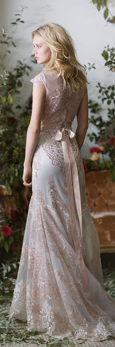 Graceful rose gold embroidery creates an extremely flattering silhouette and a stunning work of art in the Vanderbilt wedding gown by Claire Pettibone. Photo: Emily Soto https://couture.clairepettibone.com/collections/the-gilded-age/products/vanderbilt