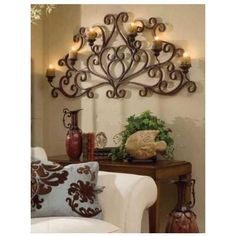 TUSCAN SCROLLED WALL GRILLE with CANDLES. The possibilities are endless with this piece. It is scrolled wrought iron that makes a perfect addition to your wall.