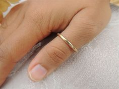 thin gold thumb ring - but even a little thinner