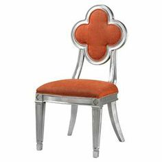 "Add a pop of color to your dining table or living room seating group with this eye-catching side chair, showcasing a flower-shaped back and silver leaf finish.     Product: Chair  Construction Material: Wood, foam and fabric  Color: Orange and silver Features:Flower-shaped backCurved back legs Dimensions:  38"" H x 18"" W x 21"" D"