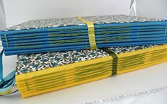 Lizzie Made: October 2012 - Fabric concertina spines. Gorgeous!