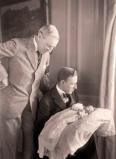 President Woodrow Wilson and his son-in-law, Francis Bowes Sayre, gaze at Francis Bowes Sayre Jr, Wilson's fourth grandchild, born in the White House on January 1915