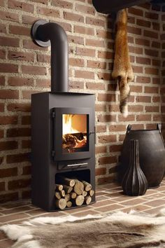 The Westfire 18 wood stove is a more or less rectangular stove with a slightly curved door. Nice proportions, easy to use and that curved door finished off the design very nicely. Wood Burner Fireplace, Wood Stove Wall, Brick Wall, Log Burner, Interior Decorating, Interior Design, Into The Woods, Cabana, Wood Burning