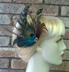 hair accessories and more... love this site for ideas on just a touch of peacock feathers in our wedding!!