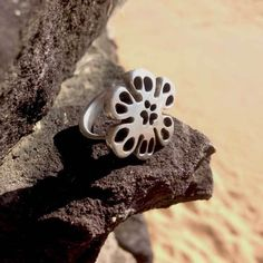 Feminine softness of a flower flowing from the snowflake form this signature ring is like the signate of old. A statement piece bold in size and spirit. #purchasewithpurpose #flower #artisan #silverring #gypset by icefromash