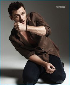Actor Luke Evans wears a brown John Varvatos shirt and denim jeans from Acne Studios for Essential Homme.