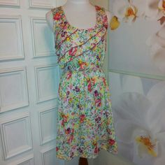 "~ EUC~ Floral Sleeveless Dress Dress is in ~excellent used condition~ Worn once, has been hand washed, lined dried. Clean ready to wear. Fabric showing no signs of wear. Looks to be a Jr's large. Measurements with dress flat - ~shoulder to bottom hem 33""  ~armpit to armpit 19""  ~elastic waist stretches up to about 19/20"" ~smoke free~ No Boundaries Dresses Midi"