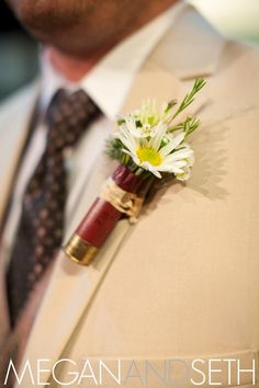 Shotgun shell boutonnière.. might shut up the country boys who don't want to were a tux :)