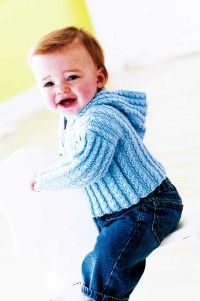 Free Knitting Patterns For Beginners | This comfortable Cabled Cardigan will keep baby warm and cozy all day.