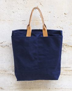 """Waxed Canvas Tokyo Bag   29 Ideal Travel Bags For Your Next Trip  $199 from Mohawk General Store. This bag has SO MANY pockets: four internal pockets, four external pockets and one large chamber. Measures 14""""w x 16""""h x 4""""d."""