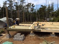 The guaranteed best method for building a rock solid front deck for your cabin that is easy to build, very low cost and will last generations Building A Small Cabin, Building A Deck, Cool Deck, Diy Deck, Deck Footings, Decking, Barn House Kits, Framing Construction, Earthship Home