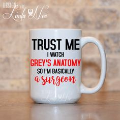 GREYs Anatomy Trust Me I watch Greys Anatomy Im Basically a Surgeon Mug, Greys Anatomy TV Show Gift, Surgeon Gift Funny Doctor Mug MSA131   AVAILABLE AS A PINBACK BUTTON ♥ ♥ ♥ ♥ ♥ ♥  AVAILABLE AS A PRINT ♥ ♥ ♥ ♥ ♥ ♥  ♥ AVAILABLE SIZES 15 oz 11 oz   ♥ ABOUT OUR MUGS ♥ All designs are personally created by me and exclusive to DesignsbyLindaNee ♥♥♥♥♥ http://etsy.me/1O2ftEU ♥♥♥♥♥ and DesignsbyLindaNeeToo ♥ Each mug is custom imprinted in our studio in Henniker, New Hampshire, using professional…