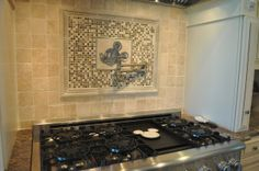Mickey Mouse tile above stove