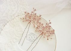 Set of 2 Rose Gold Wedding Hair Pins, Bridal Hair Accessory, Rose Gold Hair Clips, Bridal Hair Pins, Rose Gold Bridal Hair Piece, Crystal Bridal Hair Pins This divinely delicate set of 2 bridal hair pins/ hairpiece handcrafted from rose gold seed beads, rose gold Swarovski crystals and