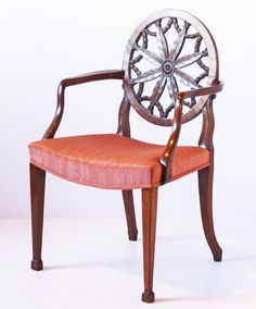 "A pair of George III mahogany Hepplewhite period wheel back open elbow chair in the manner of Robert Adam (Scottish 1728-1792) - issuing elegantly shaped arms flanking saddle seat, upholstered in later coral fabric and raised on shaped hind legs and tapering square forelegs terminating in spade feet. The underside of one chair stamped ""A.B."""