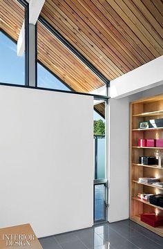 wood + white / custom shelving at contemporary interior