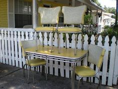 Vintage yellow formica kitchen table and chairs.