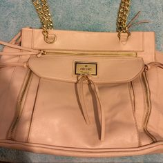 Cream color purse Amazing medium size bag with LOTS of space!! Has some color change on should straps but other than that it's perfect! No stains or loose threads! Feel free to make an offer, I never decline! Comes from a smoke free home! Bags Shoulder Bags