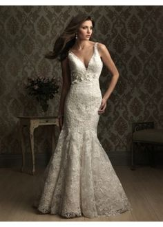 Allure Bridals 8873. This lace gown is absoutly stunning. The v-neckline is flattering as Venice lace adorns the entire fitted silhouette. A crystal, floral embellishment accents the waist as a dramatic v-shaped back. http://www.mestads.com/dresses/shopping/allure-bridals-8873.html