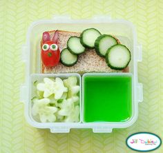 Very Hungry Caterpillar. She got half a ham and cheese sandwich. The caterpillar is made from a cherry tomato and sliced cucumbers. Mozza and cucumber eyes and cucumber nose. A container of green jello and a container of cucumber leaves.