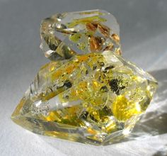 Liquid mineral oil inclusion in Quartz.