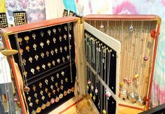 "Suitcase jewelry display with ""pages"""