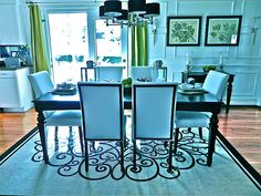 This rug is a perfect pairing to set off the straight lines in this room (table, chairs, wall molding). Home Room Design, House Design, South Shore Decorating, Wall Trim, Dining Room Table, Dining Rooms, House Rooms, Home Projects, Family Room