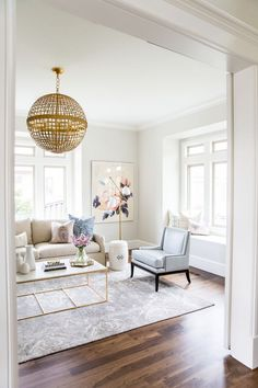 transitional living room with stunning chandeliet